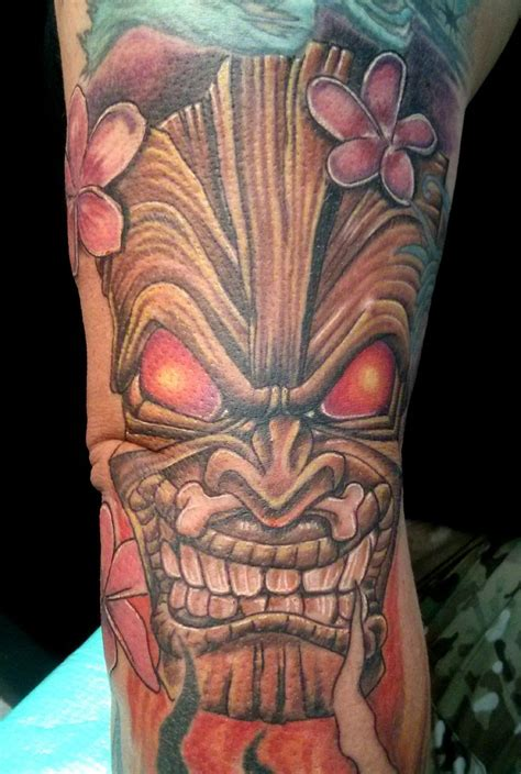 tiki mask with plumeria tattoos i did