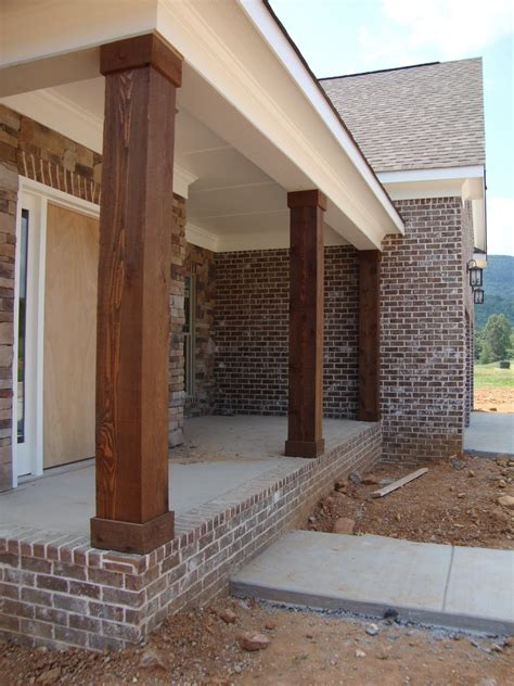 home building project cedar columns lighting and stained stairs