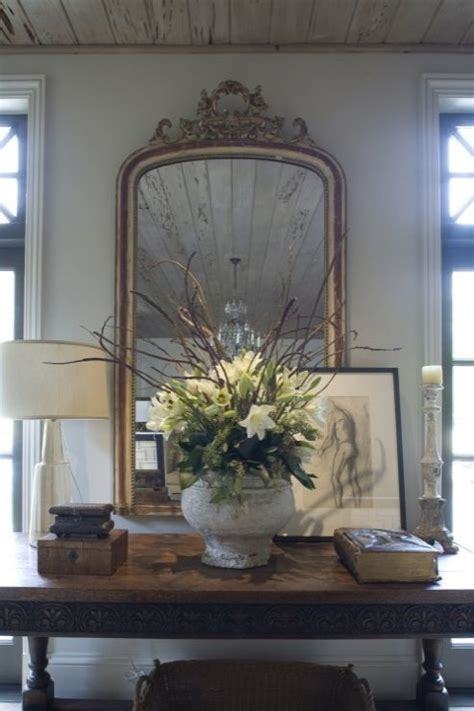 Entry Console Table With Mirror Wolter Interiors Foyer Vignette With Gold Ornate Mirror Wood Baluster Console