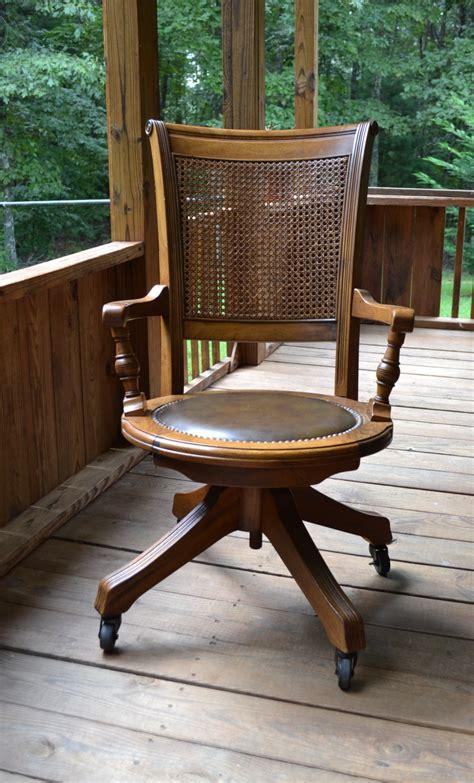 antique wooden desk chair vintage wood oak office chair swivel wheels cane back vinyl