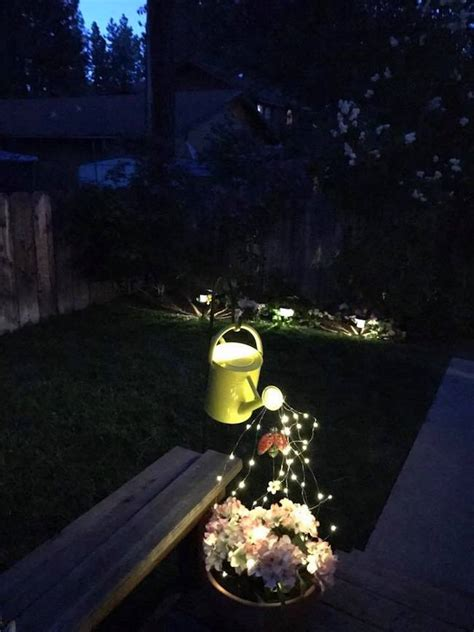 watering can with lights decorate your garden with this awesome diy glowing