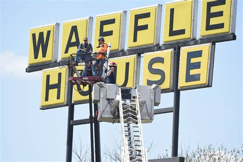 waffle house on 23rd street photo fire department rescues two from 60 foot high waffle house sign times free press