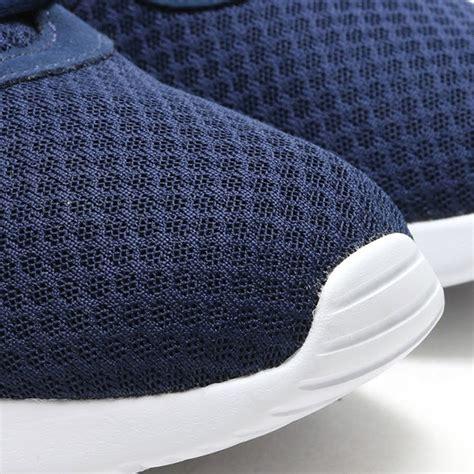 Nike Tanjun Navy White Original nike made another sneaker like the roshe called the tanjun