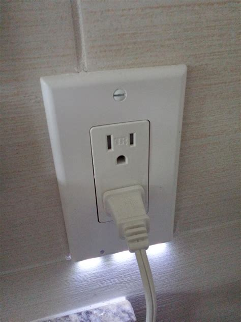built in night light outlet my parents just installed an outlet with a built in night