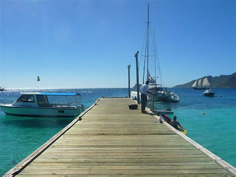 puerto rico to florida by boat marina with yachts and jetty as filming location on
