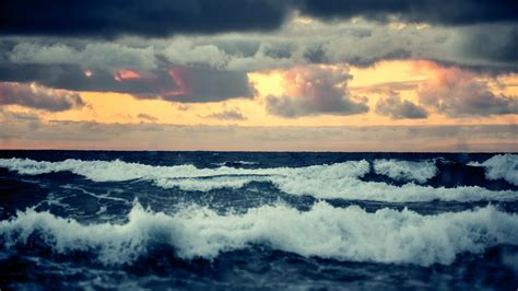 horizon waves sunset troubled sea waves clouds sea