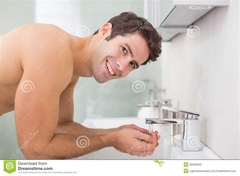 bathroom facial portrait of shirtless man washing face in bathroom royalty free stock images image