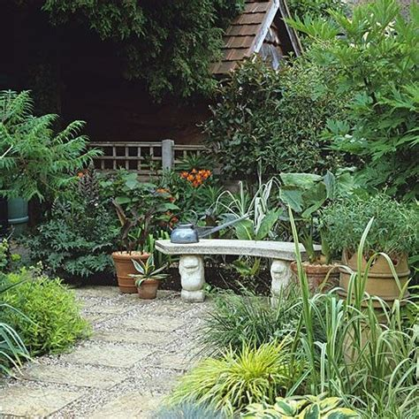 backyard courtyard ideas an inviting stone bench in a small courtyard of paving