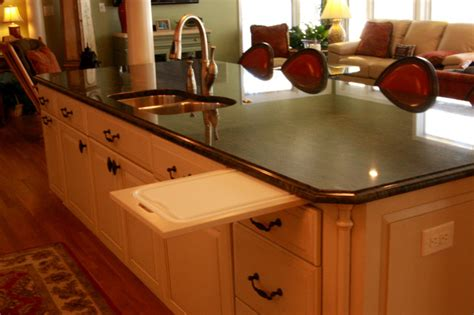 pull out cutting board in kitchen island traditional