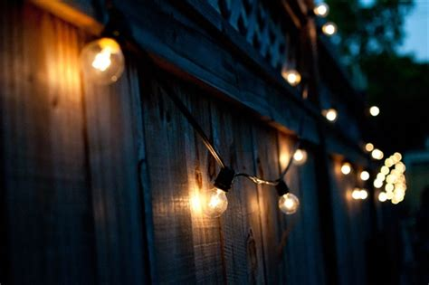 outdoor string lights on fence image pixelmari