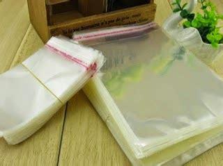 Kantong Plastik Opp Seal Lem Perekat Kemasan Baju Kaos Celana 28x37cm esa plastik