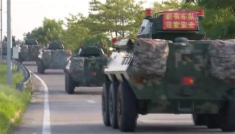 china deploys huge military convoy  shenzhen  hong