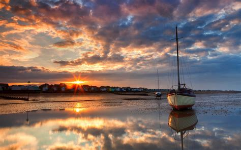 sunset boat lakes ocean sea bay harbor water reflection sky clouds