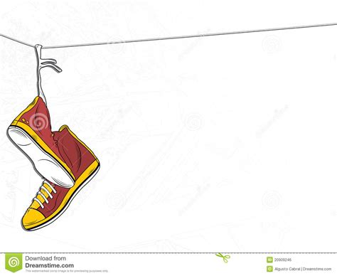 hanging photos on wire sneakers hanging on wire on white background royalty free