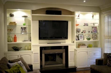 custom wall units with fireplace icicle white built in