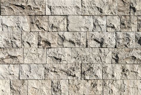 cement wall design texture background ancient stone rough texture of a rough stone wall made with blocks stock