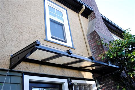 glass awning residential glass canopy vancouver repair replace installation