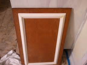add trim and a new coat of paint to cabinets for a