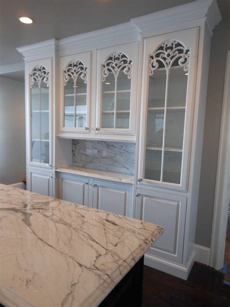Elegant carved glass cabinet doors