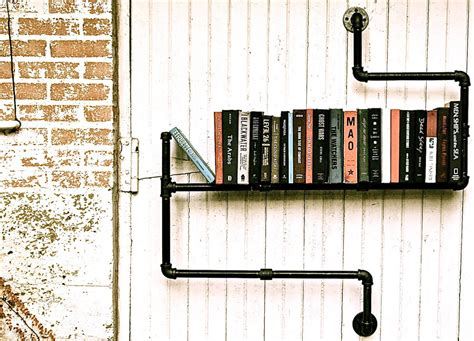 industrial pipe bookshelves by stella bleu designs
