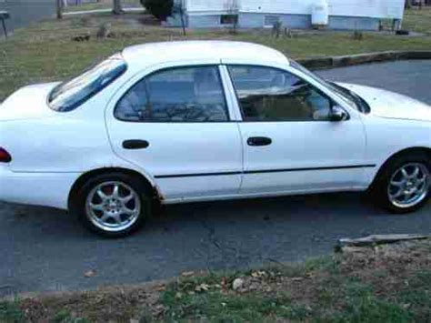 chevrolet prizm 1995, here is a chevy geo 4 door front