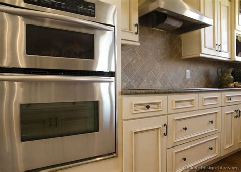 backsplash with white kitchen cabinets pictures of kitchens traditional white antique