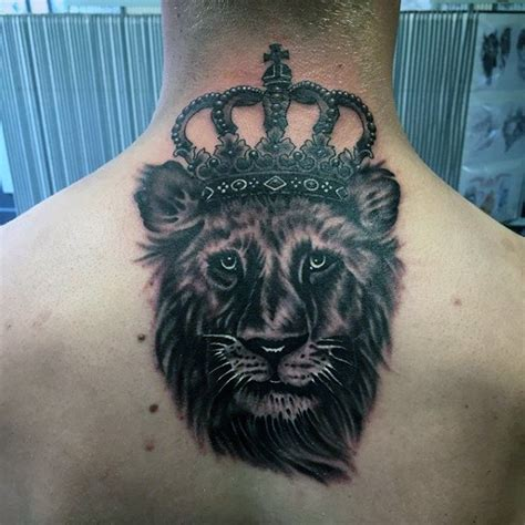 black ink crown on lion head tattoo on left arm lion head with crown tattoo www pixshark com images