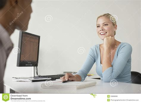 Office Worker At Desk Office Worker And Client Sitting At Desk Royalty Free Stock Photos Image 33898998