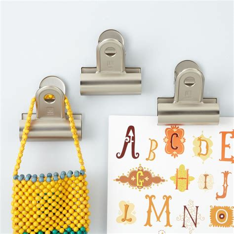 and you brought a wall clip set of 3 the land of nod kids storage kids wall mounted clips the land of nod