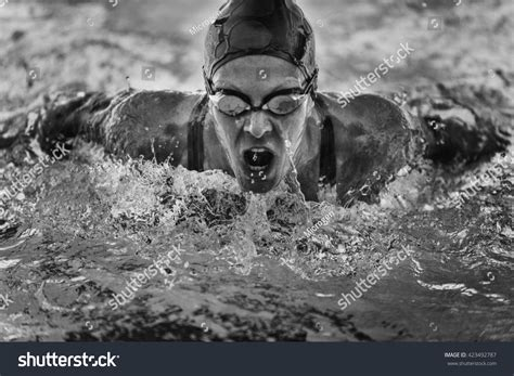 Butterfly Stroke Black powerful butterfly stroke swimming frozen motion stock photo 423492787