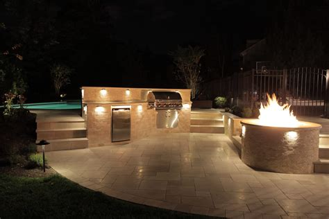 lighting for outdoor kitchen outdoor kitchen and curved deck rusk enterprises llc
