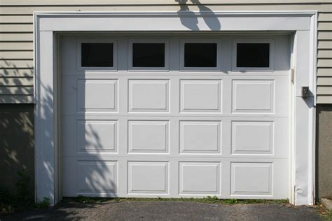 Replace Garage Door Panel With Window by A Guide To Repairing Garage Door Windows