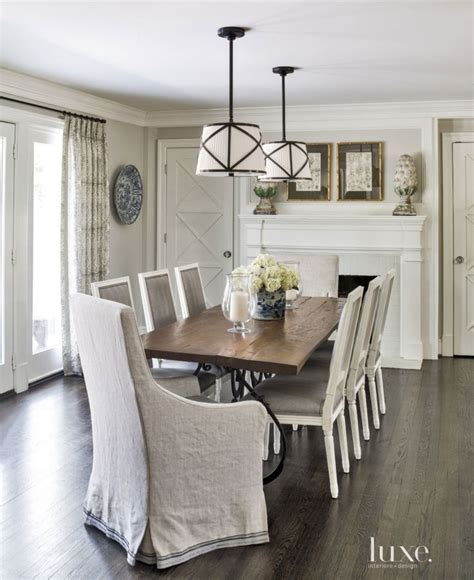contemporary white dining room with rustic reclaimed wood table luxe dining