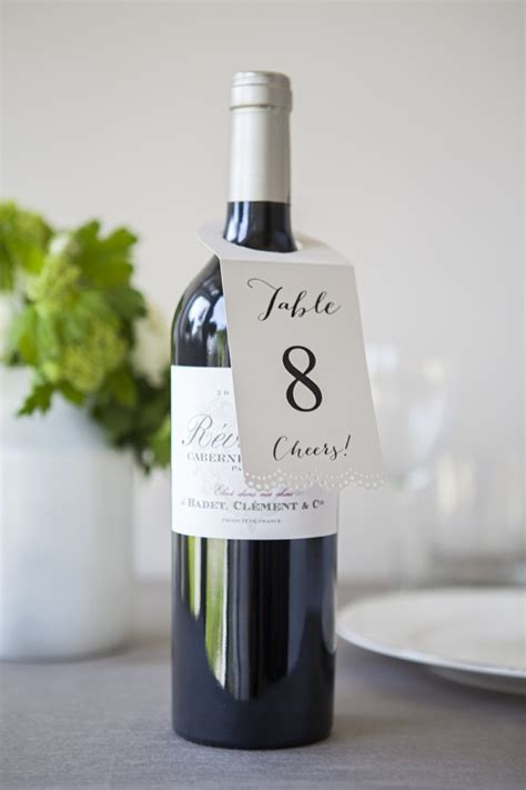 wine bottle table l diy wine bottle table numbers by jen carreiro project