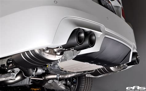 M O B Cosmetic Turner akrapovic evolution exhaust installed on frozen white f10