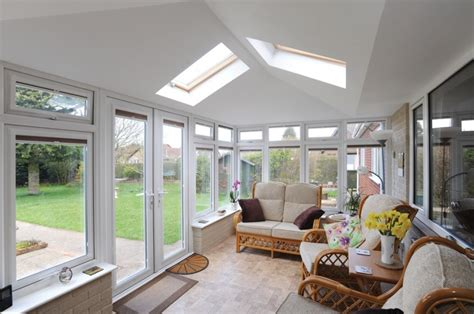 Ideal Home Interiors by Garden Rooms Solid Tiled Roof Conservatories
