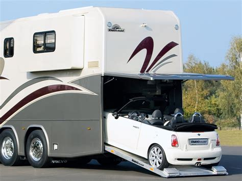 this luxury motor home comes with a parking spot for your