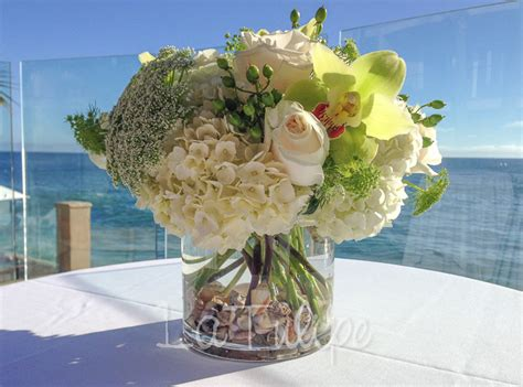 Large Party Dinner Ideas - collections of shell and flower table centre piece wedding ideas