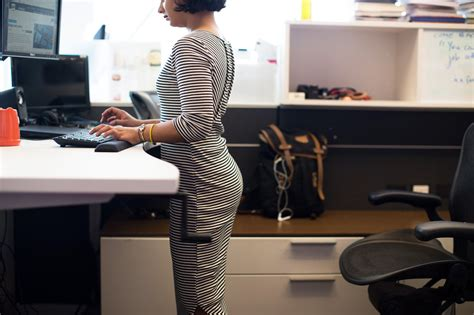standing up at your desk that standing desk might not be the magical solution