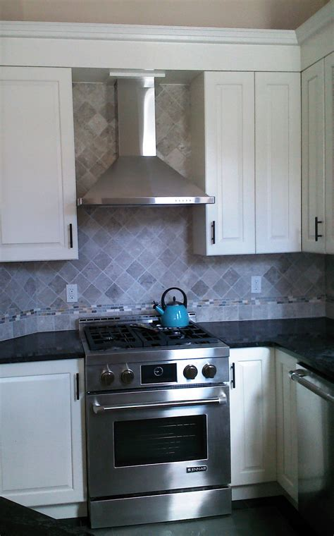 small white kitchen with steel hood we are beginning a modest and minor remodel of our kitchen