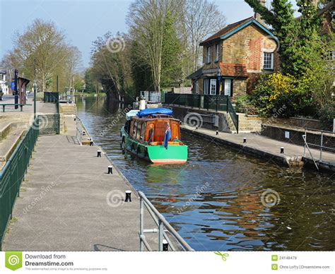 thames lock reading narrowboat leaving a lock on the river thames royalty free