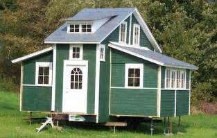 tiny mobile house expands to 420 square at