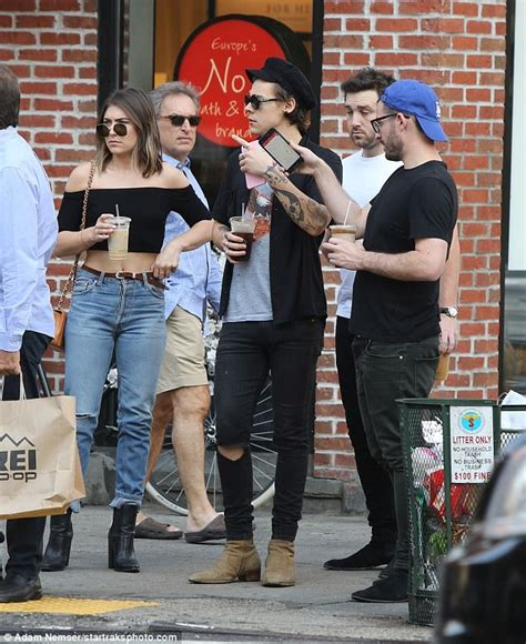 harry styles tattoo daily mail grinning harry styles rocks beatnik look in soho with pals