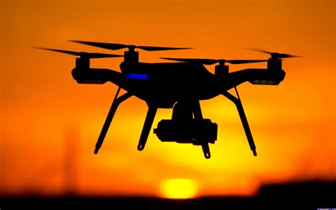 Drone Hd drone helicopter sunset silhouette sky hd background