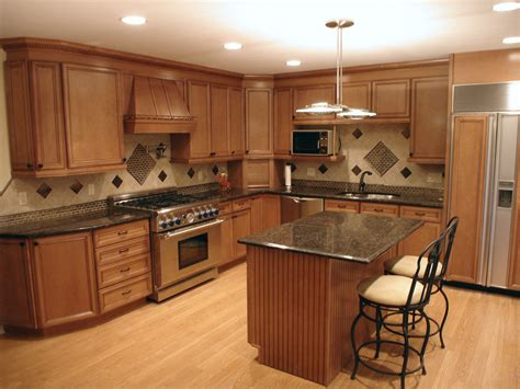 tan kitchen cabinets tan brown granite kitchen traditional with lowe s cabinets