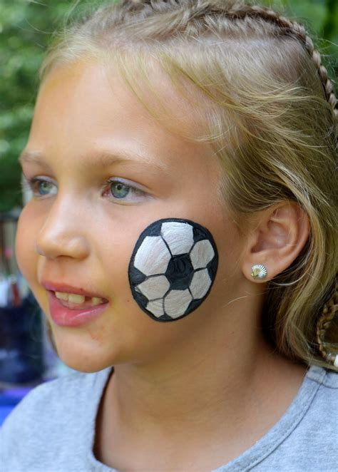 soccer ball with flames boy s face painting by let s soccer face paint www imgkid com the image kid has it