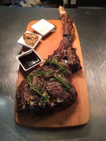 nostos kg tomahawk steak picture  nostos restaurant