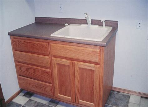 utility sink and cabinet custom laundry room and utility room cabinets