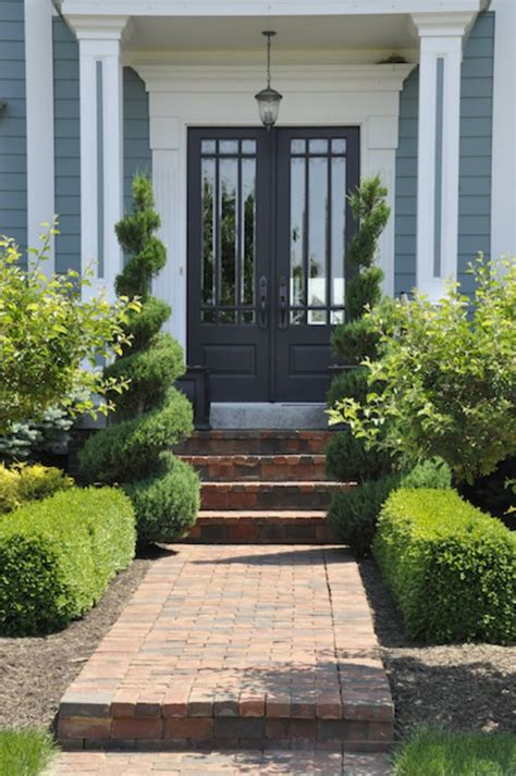 ornate shrubs and a brick walkway make this front door inviting elegant entryways pinterest