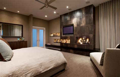 design bedroom with tv tv wall units stone fireplace custom bedding natural